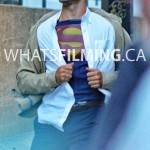 Clark Kent rips shirt open to reveal Superman suit