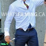 Tyler Hoechlin as Clark Kent with Superman suit peeking out of his shirt