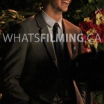Grant Gustin smiling and laughing in between takes while filming The Flash