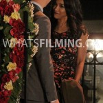 Barry and Iris talking in front of the heart-shaped prop made from flowers