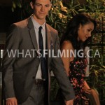 Barry and Iris holding hands as they walk while filming a scene for The Flash season 3 episode 3