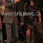 Barry and Iris holding hands as they walk while filming The Flash season 3 episode 3