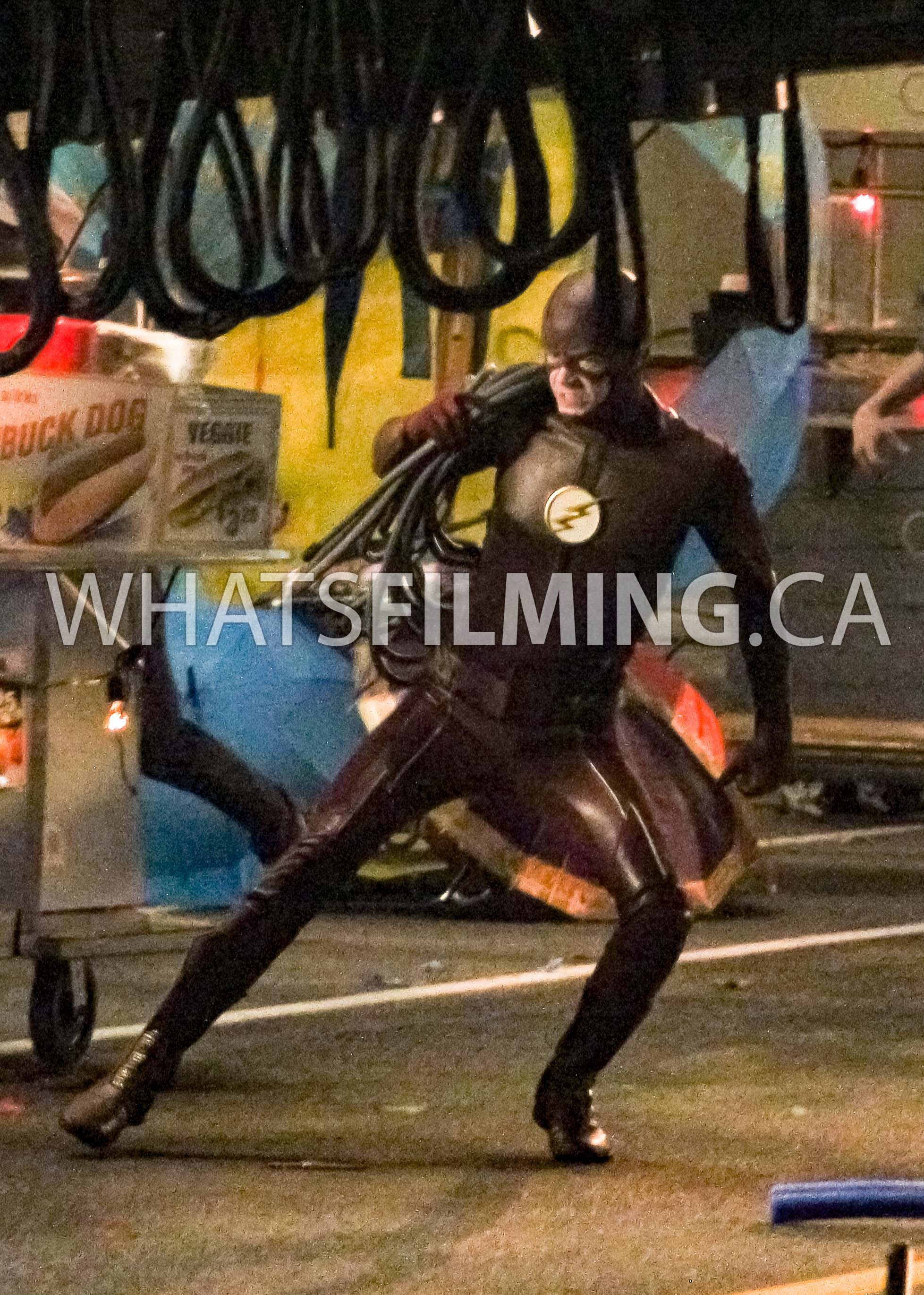 Action shot of The Flash with rope on his shoulder