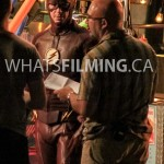 Grant Gustin and Director Kim Miles discussing the scene