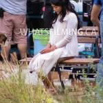 An upset Princess Jasmine sits alone on a bench