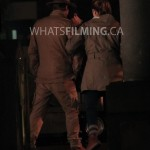 Caitlin Snow and Julian Albert lock arms as they walk while filming a scene for The Flash season 3 episode 13 in Vancouver